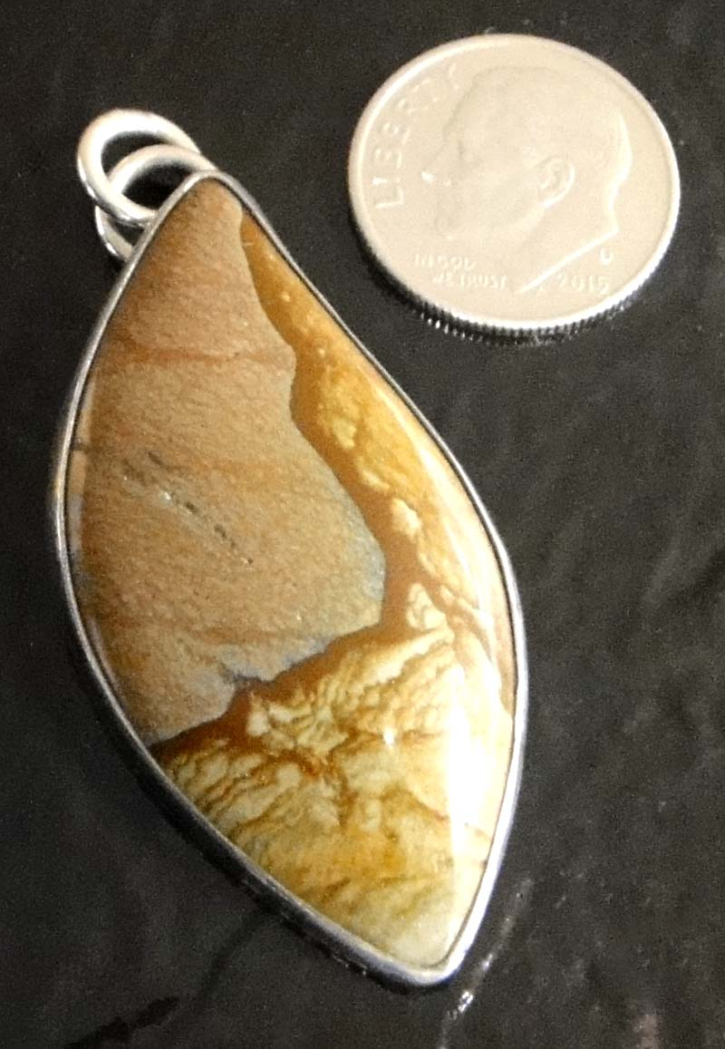 Biggs Canyon jasper and sterling silver pendant by Dale Repp with dime for size