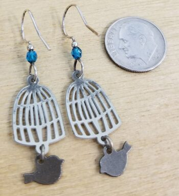 back of earrings with dime for scale