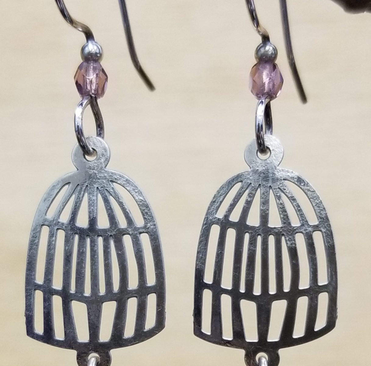Bird and birdcage earrings with violet bead