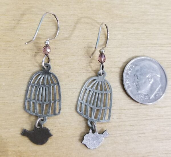 back of birdcage earrings with dime for scale