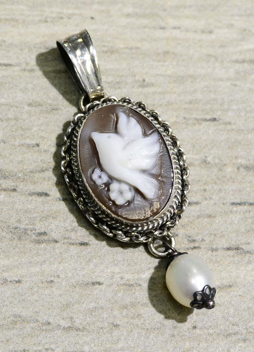 Hand carved sardonyx shell bird cameo and pearl pendant