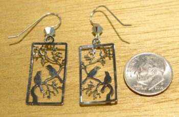 Back of birds on branch earrings with dime for scale