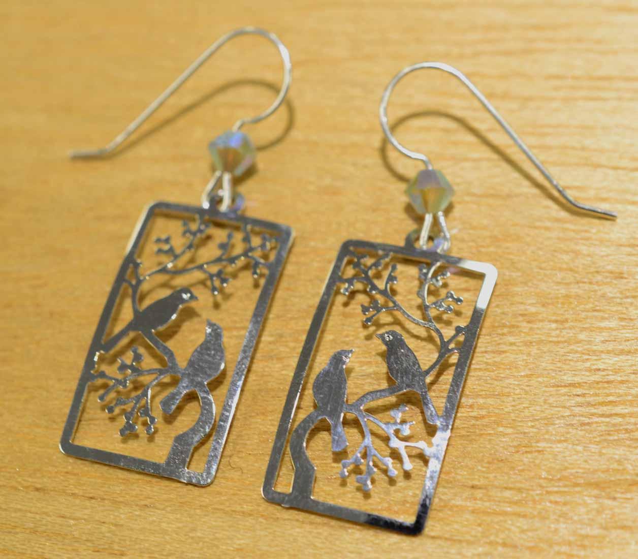 Sienna Sky silvertone birds on branch earrings