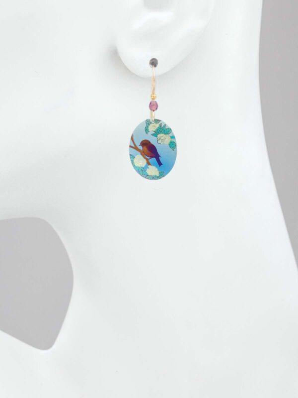bird earrings on mannequin