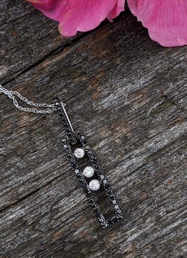 The diamonds move along a track within this pendant!