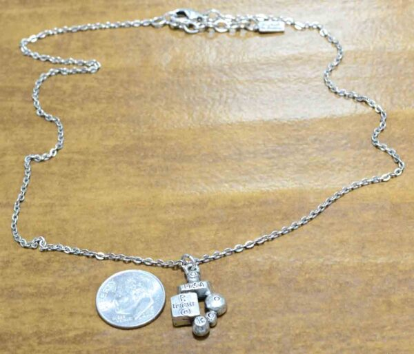 back of Park Avenue necklace by Patricia Locke with dime for size