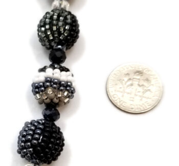 necklace detail with dime to help you gauge scale
