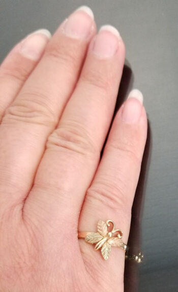 Black Hills Gold butterfly ring on hand