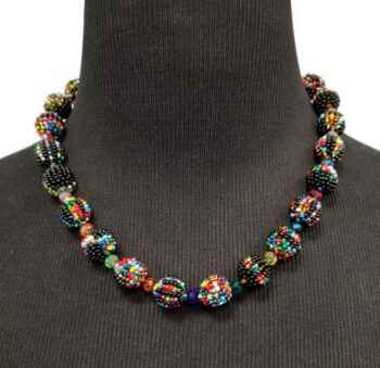 Multicolor and black seed bead art glass necklace on mannequin