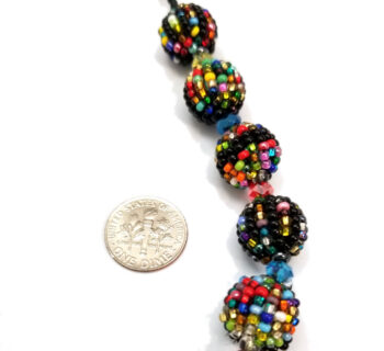 multicolor seed bead necklace with dime to help judge scale