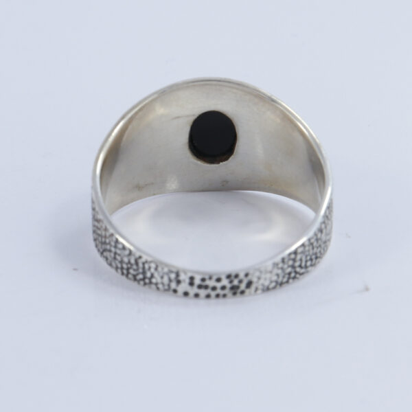 back of black onyx and sterling silver band ring