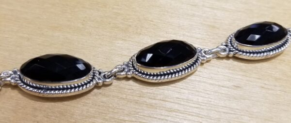 close up of side view of black onyx faceted bracelet