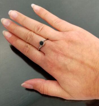 black onyx bypass style ring on hand