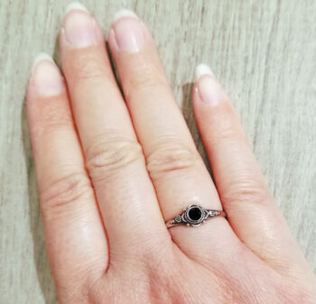 black onyx ring on hand