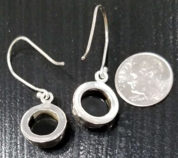 back of black onyx circle earrings with dime for scale
