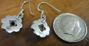 back of black onyx flower earrings with dime for size