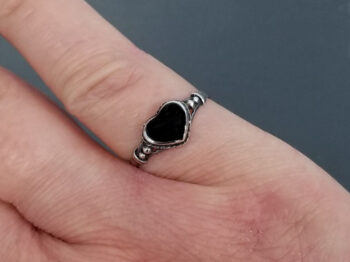 black onyx heart and sterling silver ring on hand