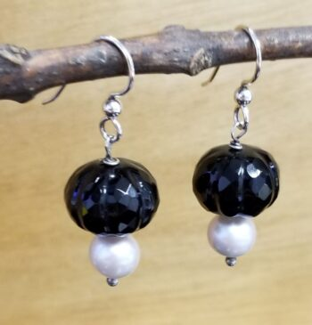 side view of onyx and pearl earrings