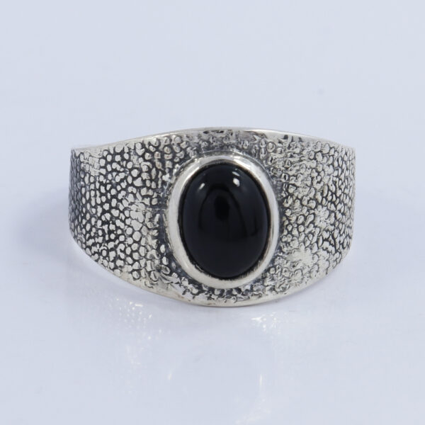 front view of black onyx and sterling silver textured band ring