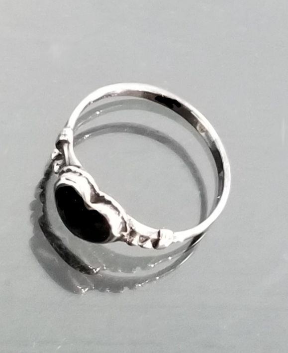 top view of black onyx heart ring