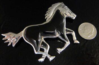 black onyx and sterling silver horse pin with dime for scale