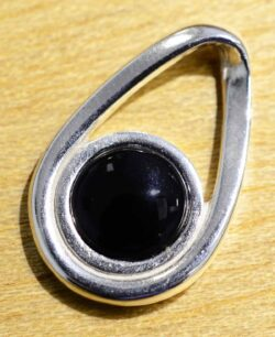 This modern black onyx and sterling silver pendant was handmade by Sonoma Art Works.