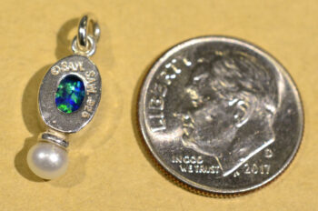 back of Sierra Designs black opal, freshwater pearl, sterling silver pendant with dime