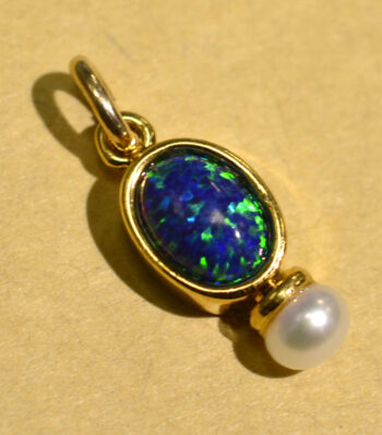 handmade black opal, freshwater pearl, and 14k gold vermeil pendant