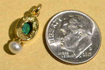 back of handmade black opal, freshwater pearl, and 14k gold vermeil pendant with dime