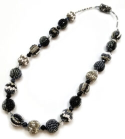 black, gray, and white beaded ball necklace