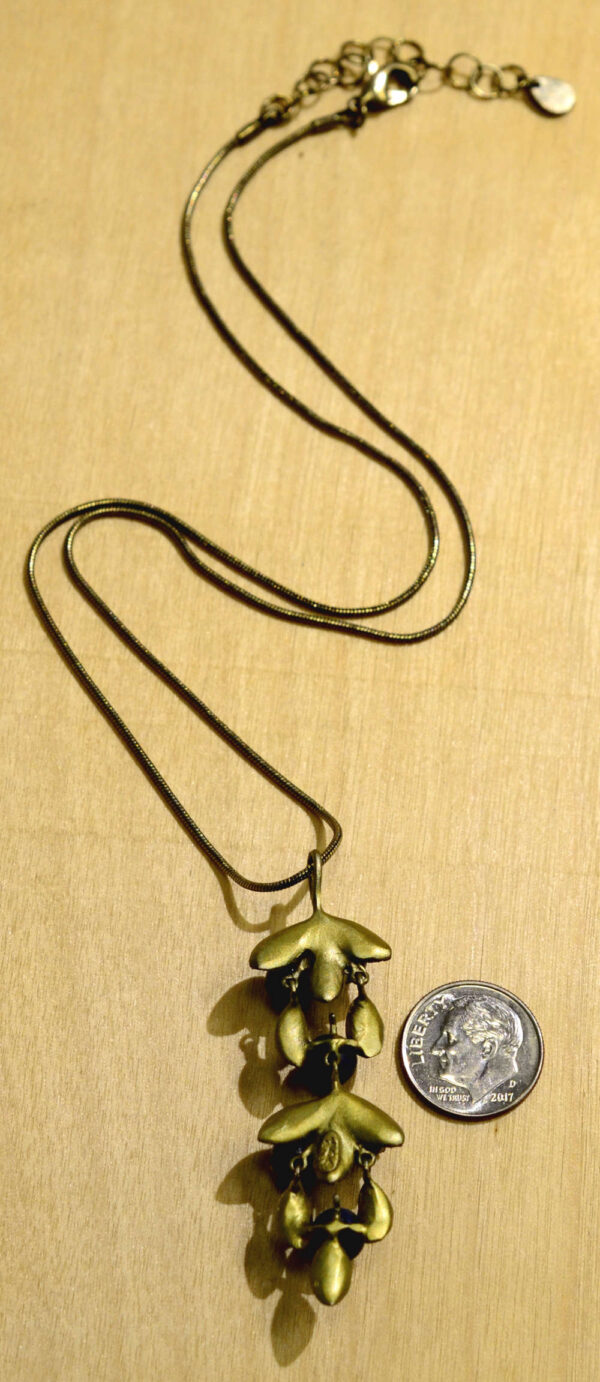 Back view of Michael Michaud blueberry pendant necklace