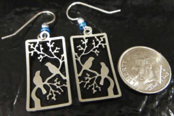 back of blue bird earrings with dime for scale