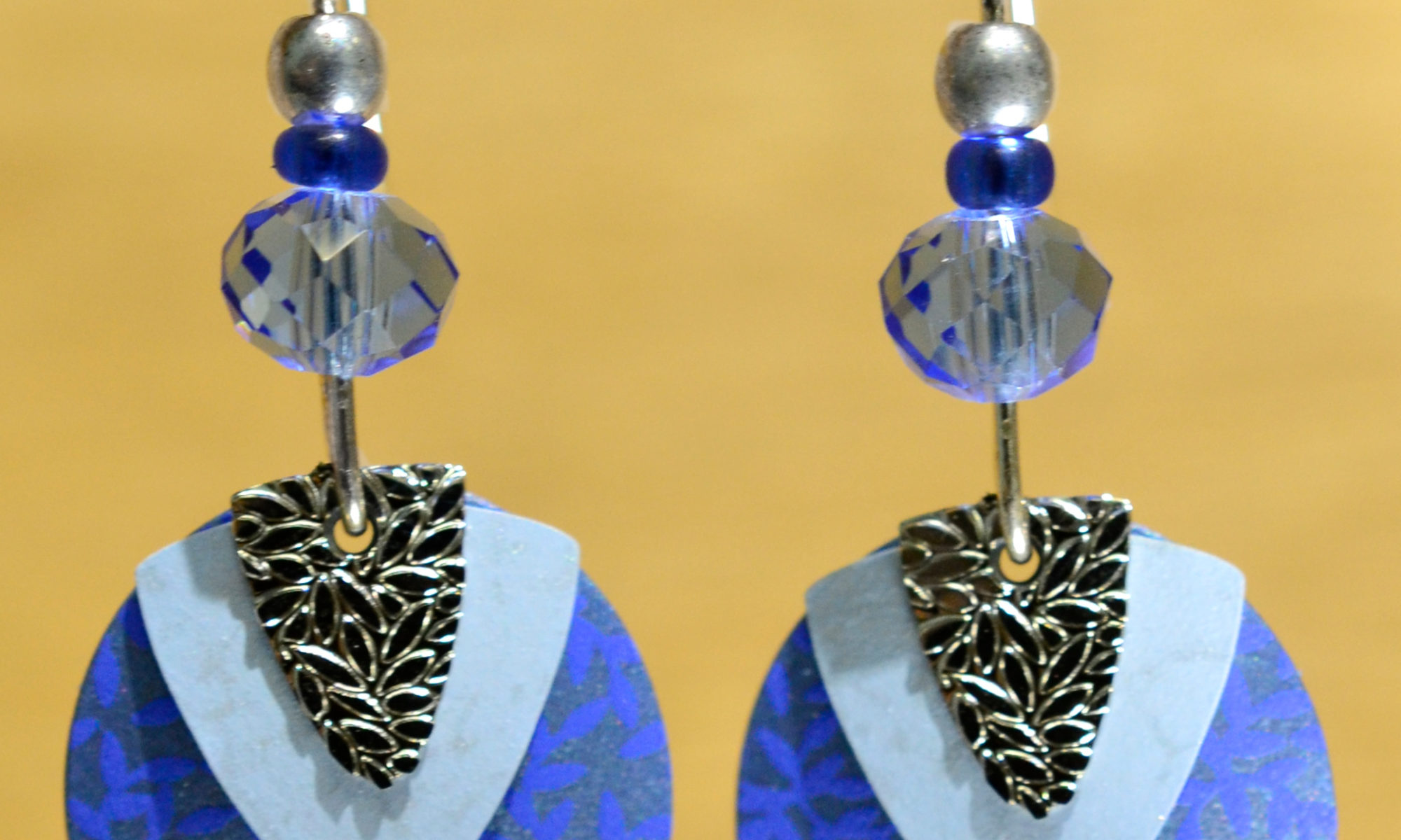 blue circle with silvertone triangle Adajio earrings