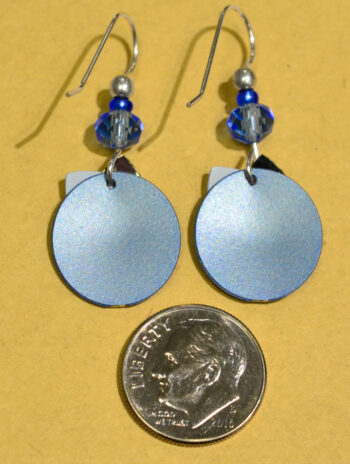 back of blue circle with silvertone triangle Adajio earrings with dime