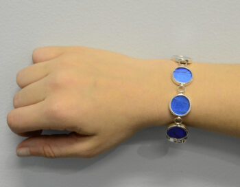 bright iridescent blue morpho real butterfly wing bracelet pictured on model