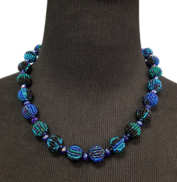 blue beaded necklace on mannequin