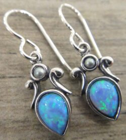 These created blue opal and freshwater pearl earrings are handmade by Sonoma Art Works.