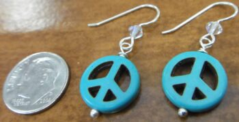 handmade blue peace sign earrings with dime for size