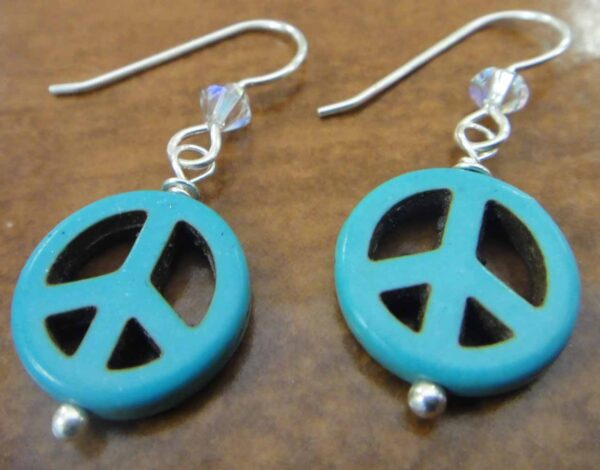 blue peace sign, Swarovski crystal bead, and sterling silver earrings handmade in Iowa City