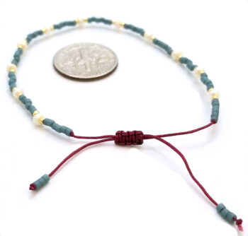 closure of bracelet with dime for scale