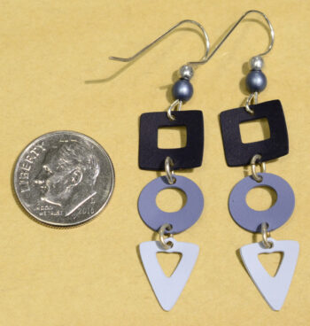 back of blue square circle and triangle Adajio earrings with dime
