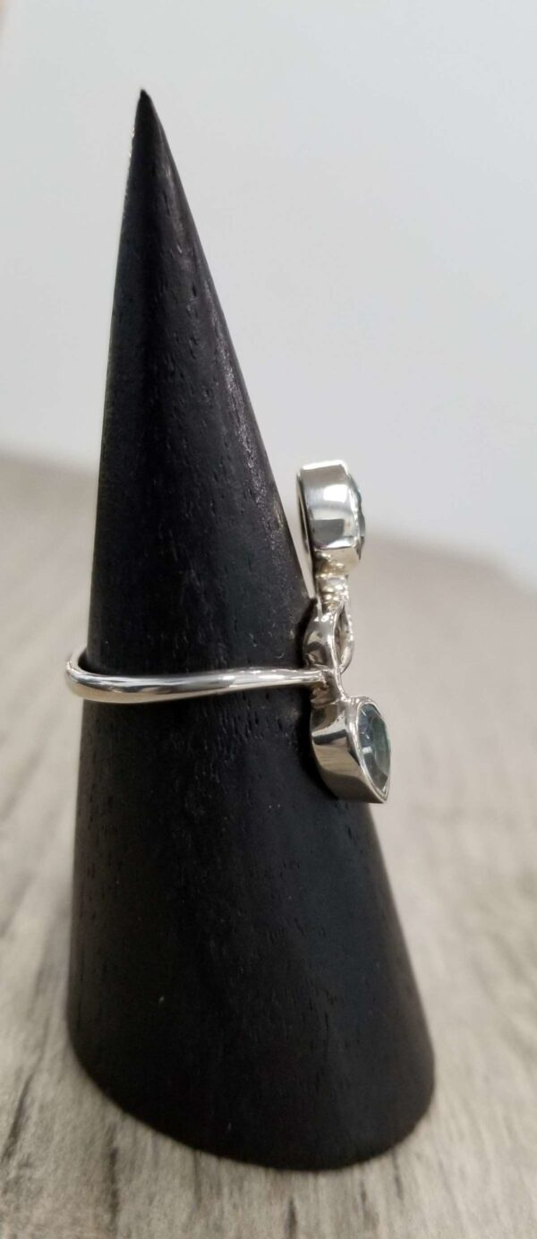side view of blue topaz ring