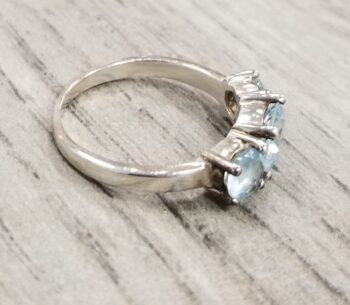 side of blue topaz ring