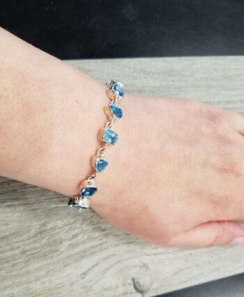 blue topaz and sterling silver bracelet on wrist
