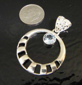 handmade blue topaz circle pendant with dime