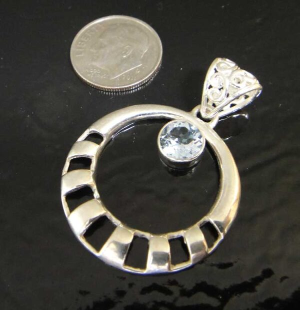 handmade blue topaz circle pendant with dime