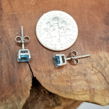 blue topaz and sterling silver earrings top view with dime for scale