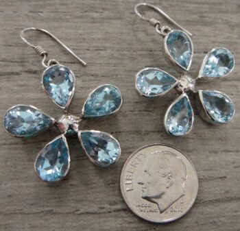 blue topaz flower earrings with dime for size