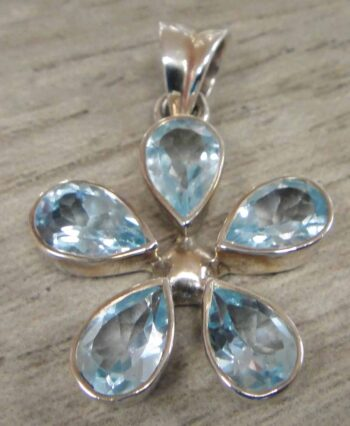 handmade blue topaz and sterling silver daisy flower pendant