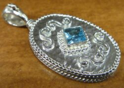 Blue topaz and sterling silver pendant by jewelry designer Anna King